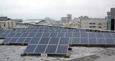 Arrays of solar panels installed on top of NSP headquarter building.