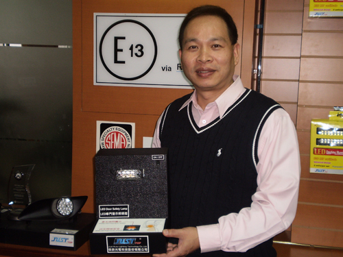 Just Auto`s vice president Jim Hsu introduces his company`s newest LED door safety lamp, to be officially unveiled at AMPA 2011.