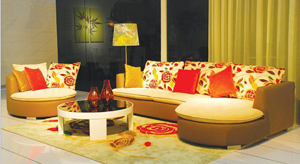 Zhejiang Kuka Technics Sofa embraces arc design for its sofa and end table.