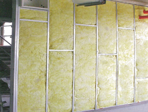 Glass fiber wool helps make Universal Cement's gypsum panels a superb nonflammable building material.