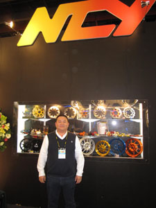 Chen Chung-jung, president of NCY, and his company`s high-end PTW tuning parts.