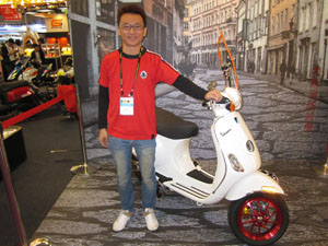 Lee Chiou-ren, NCY`s R&D manager, showcases parts and accessories developed for the Vespa LX125.