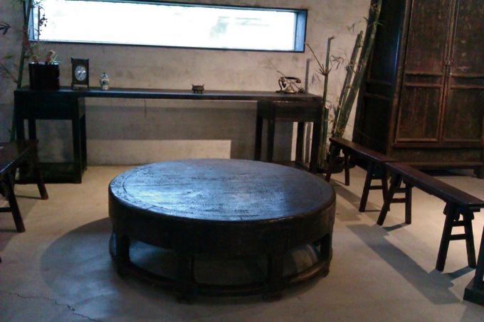 This large round table has a unique shape that contrasts sharply with the squire look of classic Chinese furniture.
