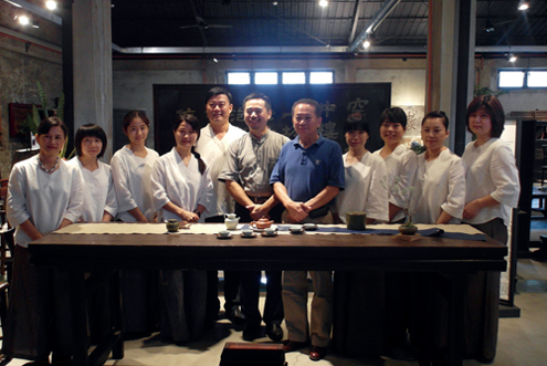 Lin Ming-san (fifth left) is one of the top collectors of Chinese antique furniture in Taiwan today. On his right is William Jiang, curator of the Furniture Manufacturing Eco-Museum in Tainan.