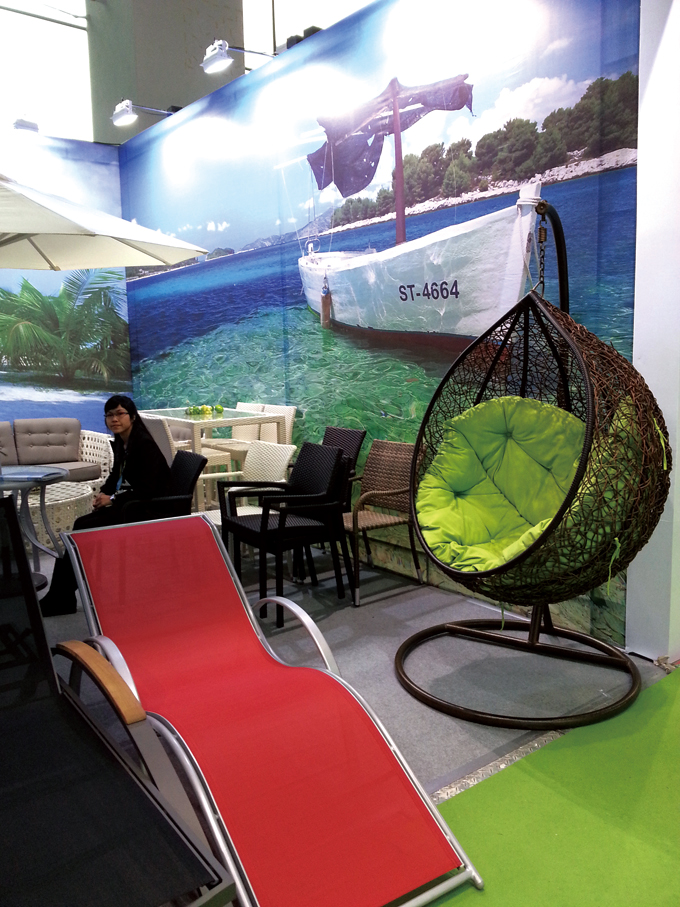 Various outdoor furniture items are showcased at 2013 China International Furniture Fair (Guangzhou).