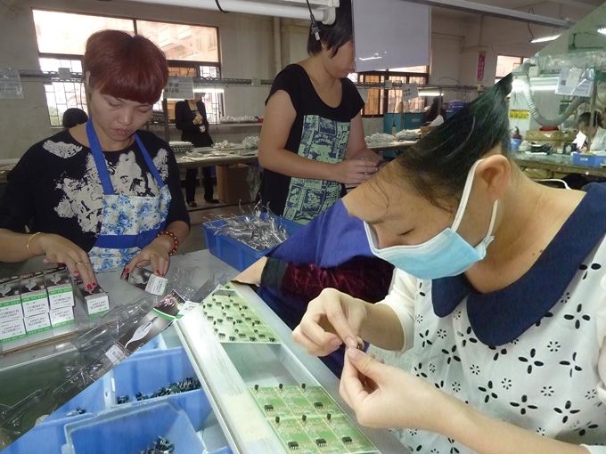 LED lighting has a promising future (workers at Gaoya are busy assembling LED lamps).