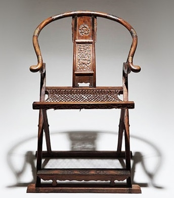 This folding Ming-style chair is a typical example of the structure and woodworking techniques of Ming-Dynasty furniture.
