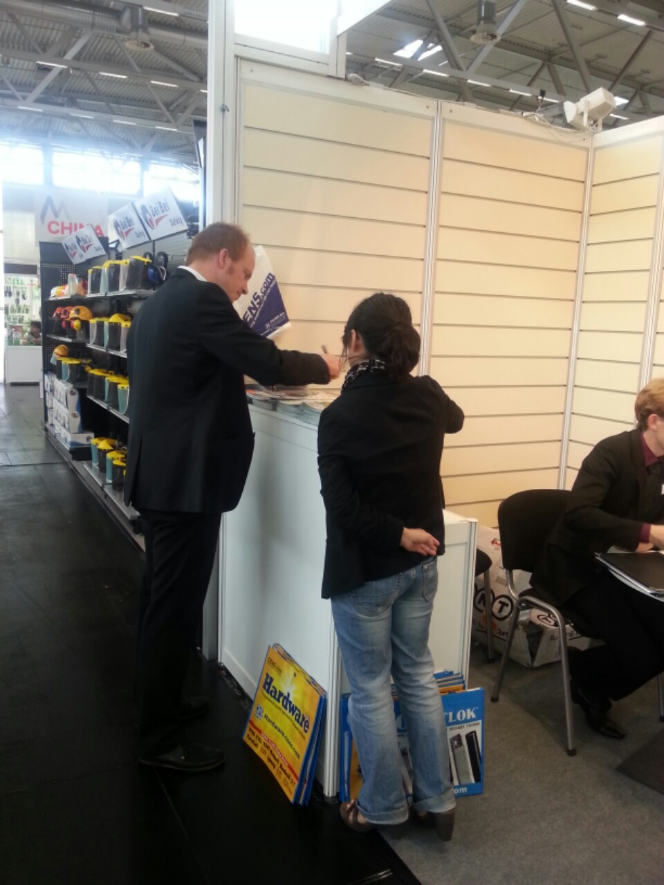A local buyer inquiring about products at CENS booth at Spoga + Gafa 2013.