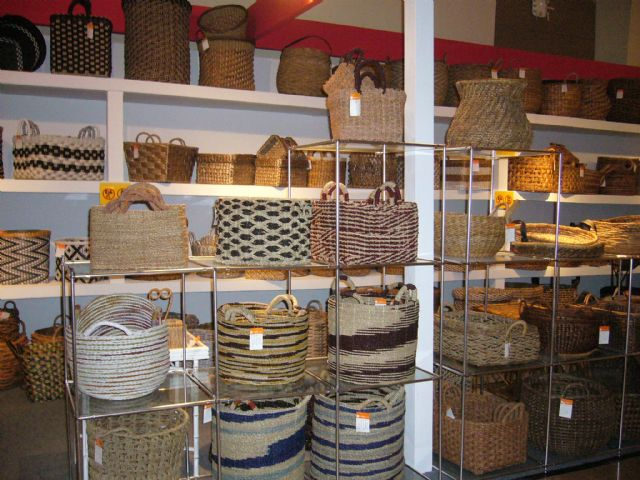 ATP uses locally-grown wicker, water hyacinth, and coco sticks to weave a wide variety of baskets, jars, bowls, and bins.