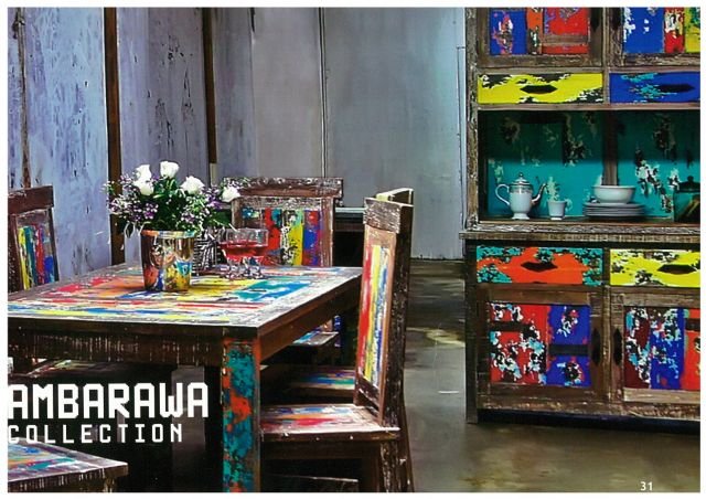 Wisanka's dining room sets are made of reclaimed boat wood showing different colors from repeated paintings.