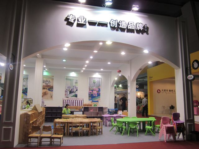 Children's furniture products on show at the 2014 China International Furniture Fair (CIFF) (Guangzhou)—Home Furniture sported plain wood and simple designs.