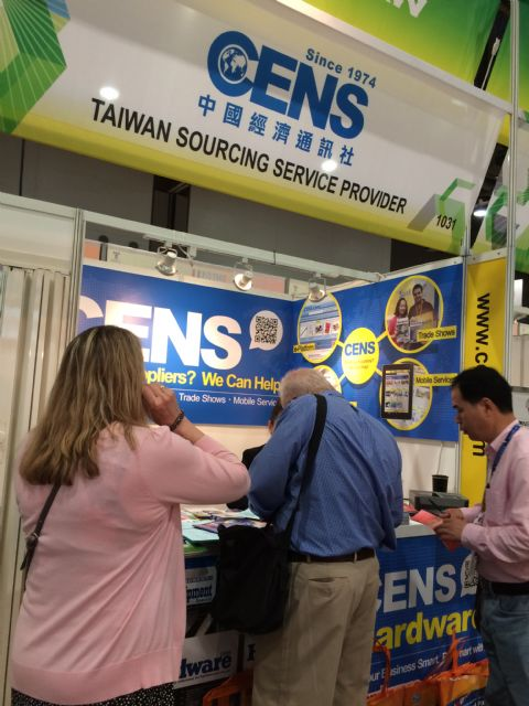 Visitors browse CENS publications at National Hardware Show.