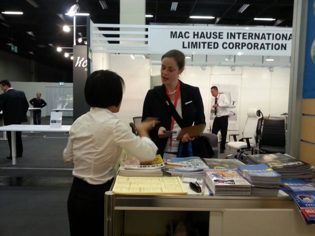 CENS representative (back to camera) helps a buyer at Orgatec.