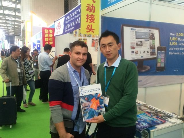 CENS representative (right) with a foreign buyer at PTC Asia.