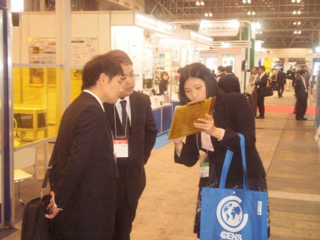 CENS representative (left) explains CENS inquiry to visitors at IPF.