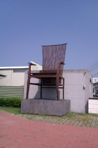 A giant chair greets visitors at the entry to the Tainan Furniture Museum.