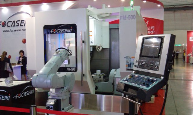 """Smart machinery composed of """"smart"""" controller, robot and machine tool."""