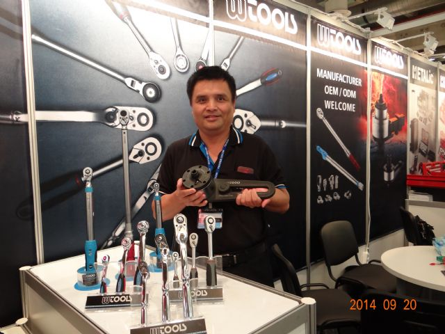 William Tools's general manager Michael Wu holds the industrial torque multiplier.