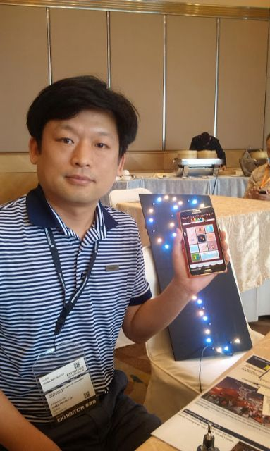 K Power Managing Director K.K. Lee and the smartphone-controlled Muse LED mood light.
