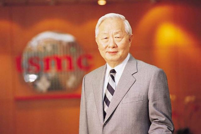 TSMC Chairman Morris Chang again cuts 2015 sales growth forecast for the chip sector.
