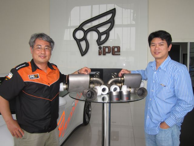 Gary Chien (right), president of Jim Technology, and Gela Wu, vice president of the company, showcase an iPE-branded top-end exhaust system made of titanium alloy for a supercar model.