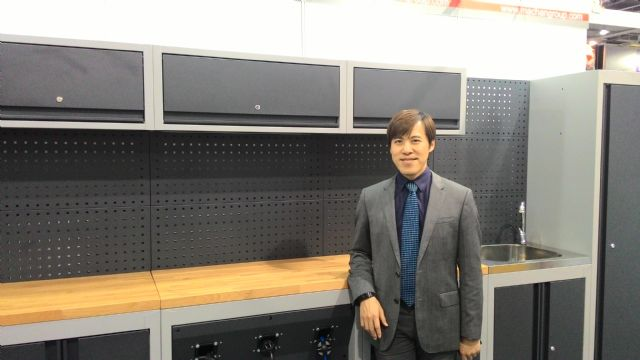 Machan Vice President Brian Chang with the company's modularized storage system.