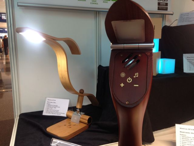 Elegant & Simply Wireless Speaker with Dimmable LED Lighting (left) demonstrated by Green First Corporation of Taiwan.