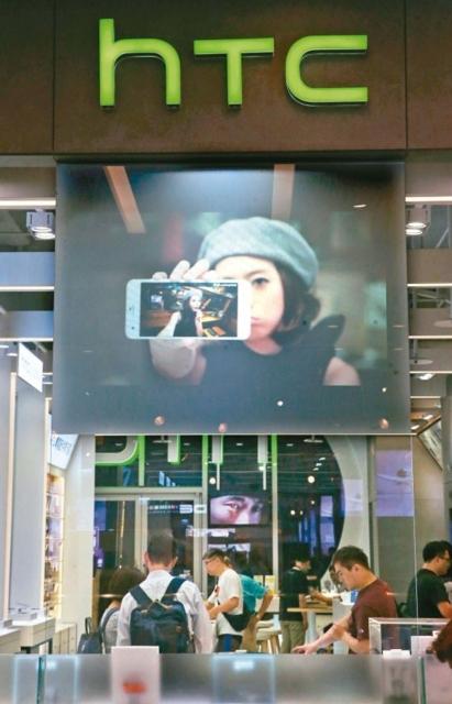 宏達電今天停牌交易,針對外傳將「下嫁」Google,宏達電表示,對謠言不予評論。 記者林俊良/攝影
