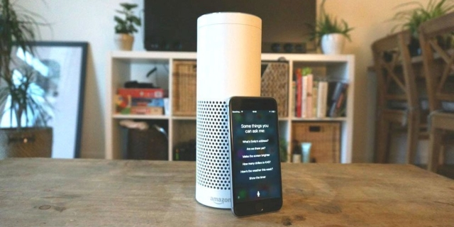 Echo (left) from Amazon and iPhone from Apple (photo courtesy of EDN.com).
