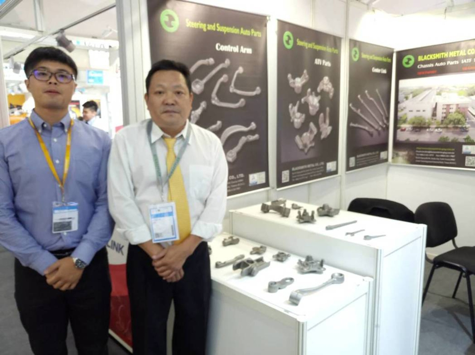 Blacksmith Metal Co. Ltd. Vice General Manager Lin Hung-Ru (right) poses beside their products. (photo courtesy of Lisa Kuo)