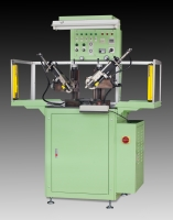 Vacuum type rubber parts trimming machine