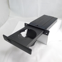 E60 front cup holder for LHD, passenger side.