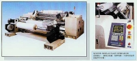 Micro-computerized, center-surface slitter & rewinder