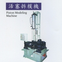 Piston mold-stripping machine
