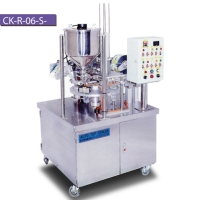 ROTARY TYPE FILLING AND SEALING MACHINE