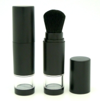 Loose powder container with hair brush