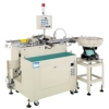 Lead wire forming and welding machine for axial-type capacitor