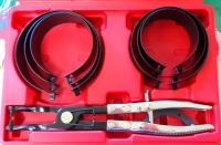 Piston spring clamp