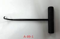 Headlight adjusting and brake spring hook