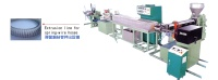 Extrusion line for spring-wire hoses