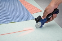 Laser-guided Rotary Knives