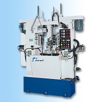 Rotary type four-station grinding machine