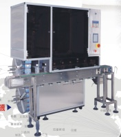 AUTO. HI.-SPEED LABEL/ TAMPER-EVIDENT SLEEVING MACHINE